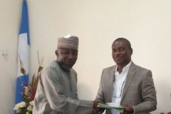 04-Barr.-Ogwuegbu-Chilezie-presenting-the-Commissions-publications-to-Alhaji-Danladi-Ibrahim-of-NIWA-who-represented-the-Managing-Director-Cida-Mustapha