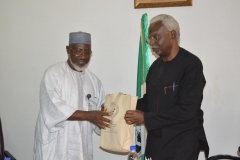 DSC_0062-ICPC-Chairman-Mr.-Ekpo-Nta-presenting-some-of-the-Commissions-IEC-materials-to-Dr.-Mohammed-Sanusi